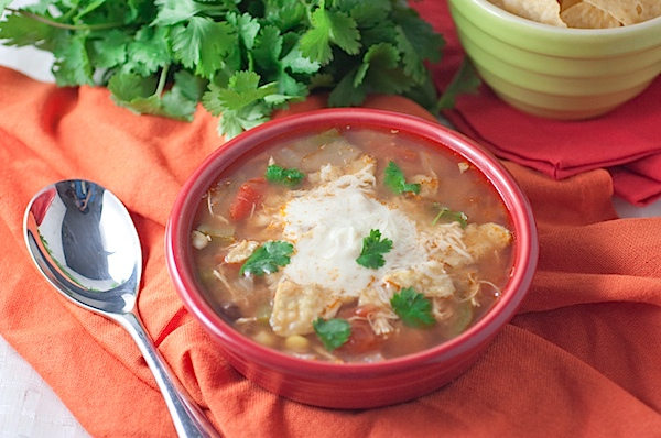 Cozy up with this easy Slow Cooker Chicken Tortilla Soup Recipe. This delicious dinner recipe is a clean eating take on the classic with the ease of crockpot cooking. #recipe #healthy #healthyrecipes #healthyfood #cleaneating #chicken #dinner #dinnerrecipes
