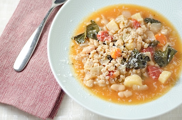 Get cozy with this comforting bowl of Vegetarian Italian Farro Soup recipe. This clean eating recipe makes a delicious lunch or dinner that will keep you full while you feel light. Try this easy soup recipe. #recipe #healthy #healthyrecipes #cleaneating #recipe #realfood #vegan #vegetarian