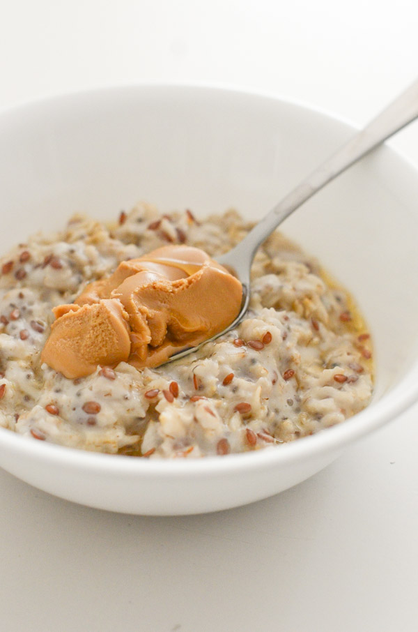 Want a healthy breakfast recipe fast? Try this easy and delicious Honey Flax Almond Butter Oatmeal Recipe. It's perfect when you haven't been to the grocery store since it uses simple pantry ingredients. Vegan options. #recipe #healthy #healthyrecipes #cleaneating #recipe #realfood #vegan #vegetarian