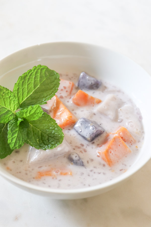 Looking for a healthy dessert/snack recipe? Try this easy and delicious sweet potato/taro root, coconut milk recipe for Ginataang. This Filipino treat is a FUN clean eating recipe to sneak healthy root vegetables into your diet. #recipe #healthy #healthyrecipes #cleaneating #vegan #vegetarian #desserts #dessertfoodrecipes