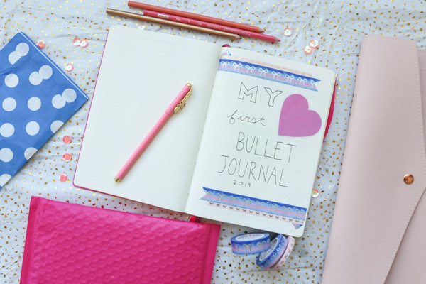 Here's a super EASY idea for a Bullet Journal title page for your first bullet journal. Make it look pretty without drawing by using washi tape and stickers. Click for supplies used #bulletjournal #bulletjournalideas #bujo #planner