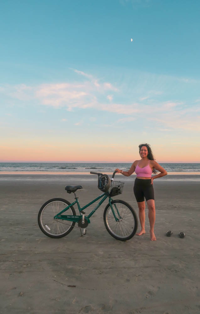 Diana at Kiawah Island Resort beach with a bicycle